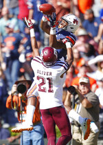 Auburn wide receiver Seth Williams (18) leaps above Texas A&M defensive back Charles Oliver (21) for a touchdown reception during the first half of an NCAA college football game, Saturday, Nov. 3, 2018, in Auburn, Ala. (AP Photo/Todd Kirkland)