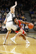 Georgia guard Sahvir Wheeler, right, drives against Vanderbilt forward Oton Jankovic (55) in the first half of an NCAA college basketball game Saturday, Feb. 22, 2020, in Nashville, Tenn. (AP Photo/Mark Humphrey)