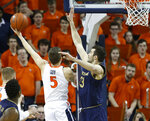 Virginia guard Kyle Guy (5) goes up for a shot as Notre Dame forward John Mooney (33) defends during the first half of an NCAA college basketball game in Charlottesville, Va., Saturday, Feb. 16, 2019. (AP Photo/Steve Helber)