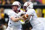 Elon's Davis Cheek hands off to Jaylan Thomas during the second quarter against Appalachian State during an NCAA college football game in Boone, N.C., Saturday, Sept. 18, 2021. (Kenneth Ferriera/News & Record via AP)