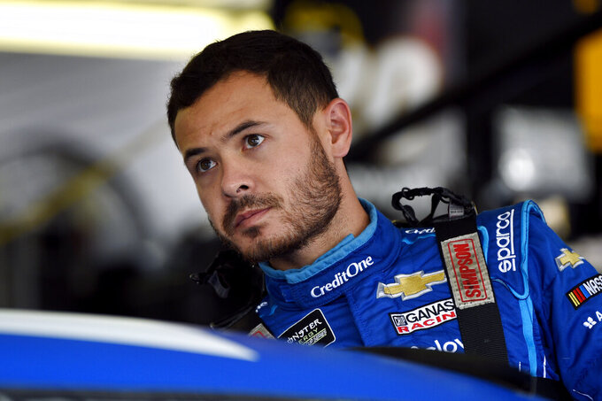 Kyle Larson climbs into his car for a practice session for Sunday's NASCAR Cup Series auto race, Saturday, July 27, 2019, in Long Pond, Pa. (AP Photo/Derik Hamilton)