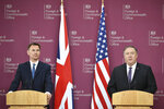 US Secretary of State Mike Pompeo, right, and Britain's Foreign Secretary Jeremy Hunt attend a joint press conference at the Foreign Office in central London, Wednesday May 8, 2019. U.S. Secretary of State Mike Pompeo is in London for talks with British officials on the status of the special relationship between the two nations amid heightened tensions with Iran and uncertainty over Britain's exit from the European Union. (Mandel Ngan/Pool via AP)