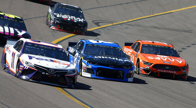 Denny Hamlin (11), Daniel Hemric (8) and Clint Bowyer (14) race out of Turn 4 during the NASCAR Cup Series auto race at ISM Raceway, Sunday, March 10, 2019, in Avondale, Ariz. (AP Photo/Ralph Freso)