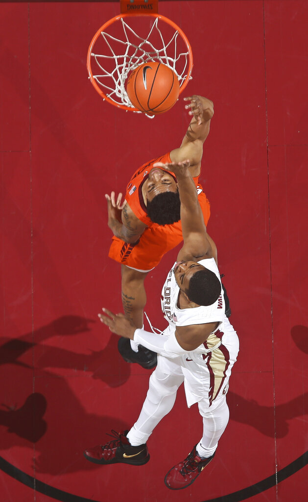 At top, Virginia Tech guard Nickeil Alexander-Walker goes for a layup, but misses as Florida State guard MJ Walker (23) defends in the first half of an NCAA college basketball game in Tallahassee, Fla., Tuesday, March 5, 2019. (AP Photo/Phil Sears)