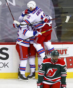 New Jersey Devils defenseman P.K. Subban (76) skates back to the bench as the New York Rangers celebrate a goal by center Kevin Rooney (obscured) during the first period of an NHL hockey game in Newark N.J., on Saturday, March 6, 2021. (Andrew Mills/NJ Advance Media via AP)