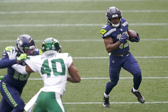 Seattle Seahawks' Penny Hart (19) runs with the ball against the New York Jets during the first half of an NFL football game, Sunday, Dec. 13, 2020, in Seattle. (AP Photo/Ted S. Warren)