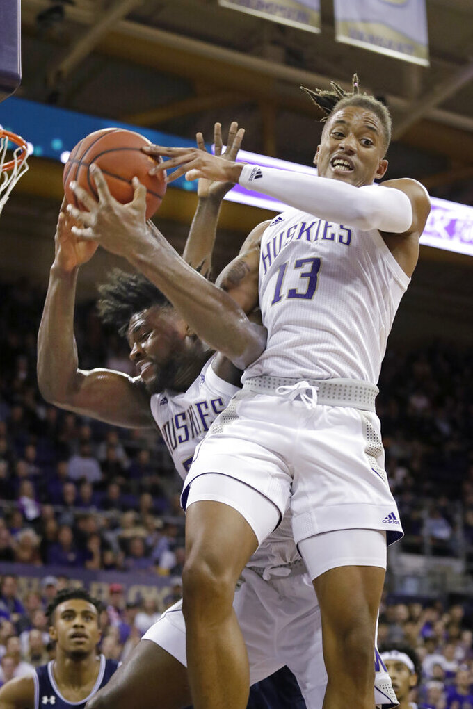 Washington's Hameir Wright and Isaiah Stewart vie for a loose ball against Mount St. Mary's during the second half of an NCAA college basketball game Tuesday, Nov. 12, 2019, in Seattle. Washington won 56-46. (AP Photo/Elaine Thompson)