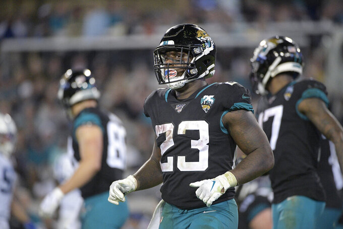"FILE - Jacksonville Jaguars running back Ryquell Armstead (23) sets up for a play during the second half of an NFL football game against the Indianapolis Colts Sunday, Dec. 29, 2019, in Jacksonville, Fla. Armstead is expected to miss significant time after landing on the COVID-19 list for the second time in five weeks. Coach Doug Marrone says Armstead will be sidelined ""a while."" ""I can't put a real timetable on it, but he'll be out for a while,"" Marrone said Monday, Sept. 7, 2020.(AP Photo/Phelan M. Ebenhack, File)"