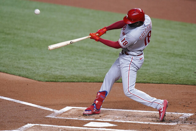 Philadelphia Phillies' Didi Gregorius hits a grand slam, also scoring Bryce Harper, J.T. Realmuto and Rhys Hoskins, during the first inning of a baseball game against the Miami Marlins, Saturday, Sept. 12, 2020, in Miami. (AP Photo/Wilfredo Lee)