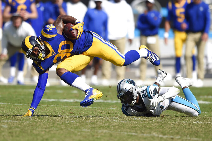Los Angeles Rams running back Todd Gurley (30) is tripped up by Carolina Panthers cornerback James Bradberry (24) during the second half of an NFL football game in Charlotte, N.C., Sunday, Sept. 8, 2019. (AP Photo/Mike McCarn)