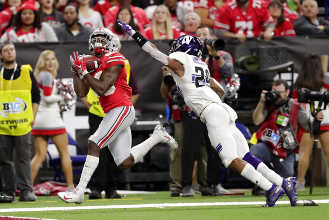 Ohio State wide receiver Terry McLaurin, left, makes a touchdown reception against Northwestern defensive back Greg Newsome II during the first half of the Big Ten championship NCAA college football game, Saturday, Dec. 1, 2018, in Indianapolis. (AP Photo/Michael Conroy)