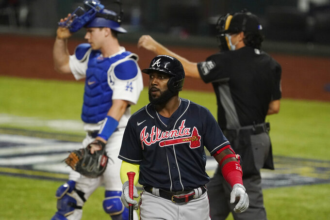 Atlanta Braves' Marcell Ozuna walks to the dugout after striking out during the sixth inning in Game 7 of a baseball National League Championship Series against the Los Angeles Dodgers Sunday, Oct. 18, 2020, in Arlington, Texas. (AP Photo/Tony Gutierrez)