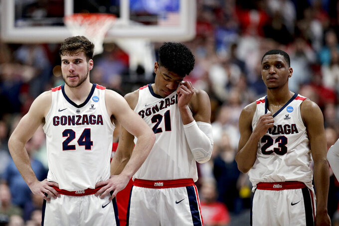 Gonzaga forward Corey Kispert, forward Rui Hachimura and guard Zach Norvell Jr., from left, stand on the court after the team's loss to Texas Tech in the West Regional final in the NCAA men's college basketball tournament Saturday, March 30, 2019, in Anaheim, Calif. Texas Tech won 75-69. (AP Photo/Jae C. Hong)