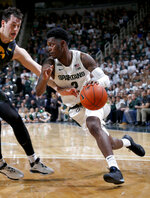 Michigan State's Rocket Watts, right, drives against Iowa's Ryan Kriener during the second half of an NCAA college basketball game, Tuesday, Feb. 25, 2020, in East Lansing, Mich. Michigan State won 78-70. (AP Photo/Al Goldis)