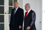 President Donald Trump and Israeli Prime Minister Benjamin Netanyahu walk to a meeting in the Oval Office of the White House, Monday, Jan. 27, 2020, in Washington. (AP Photo/ Evan Vucci)