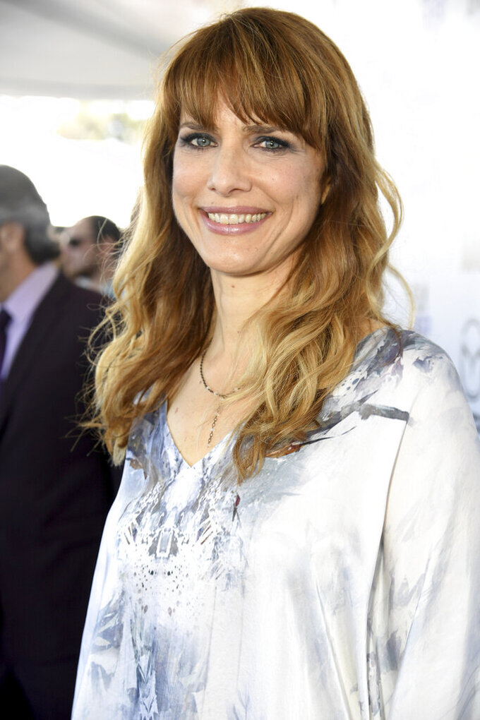 """FILE - In this Feb. 8, 2020, file photo, director Lynn Shelton arrives at the 35th Film Independent Spirit Awards, in Santa Monica, Calif. Shelton, an independent filmmaker who directed """"Humpday"""" and """"Little Fires Everywhere,"""" has died at age 54. Shelton's publicist, Adam Kersh, said in a statement Saturday, May 16, 2020, that she died Friday in Los Angeles from an unidentified blood disorder. (Photo by Richard Shotwell/Invision/AP, File)"""
