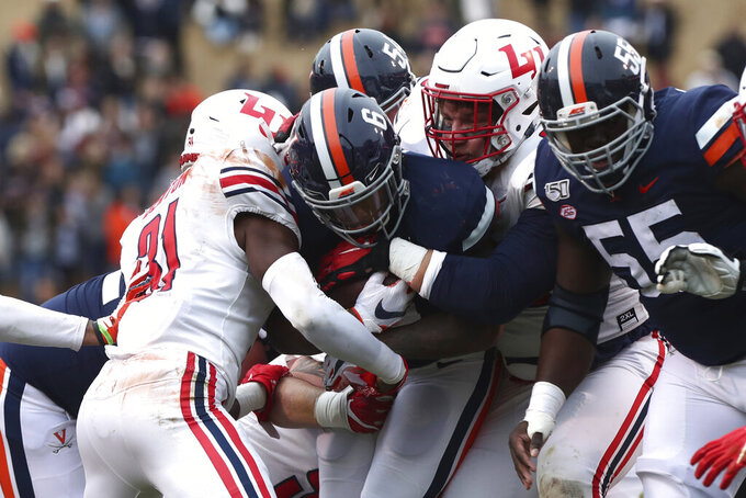 Virginia's PK Kier (6) is stopped by the Liberty defense  during an NCAA college football game Saturday, Nov. 23, 2019, in Charlottesville, Va. (Erin Edgerton/The Daily Progress via AP)