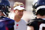 FILE - In this Aug. 9, 2021, file photo, Mississippi coach Lane Kiffin speaks with his players during NCAA college football practice in Oxford, Miss., Monday,. Mississippi takes on Louisville in Monday night's Chick-Fil-A Kickoff game that wraps up college football's first full weekend.   (AP Photo/Rogelio V. Solis, File)