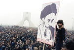 FILE - In this Oct. 9, 1978 file photo, Iranian protesters demonstrate against Shah Mohammad Reza Pahlavi in Tehran, Iran. (AP Photo/File)