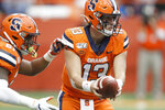 Syracuse's Tommy DeVito, right, hands the ball off to Syracuse's Moe Neal, left, during the first quarter of an NCAA college football game against Boston College in Syracuse, N.Y., Saturday, Nov. 2, 2019. (AP Photo/Nick Lisi)