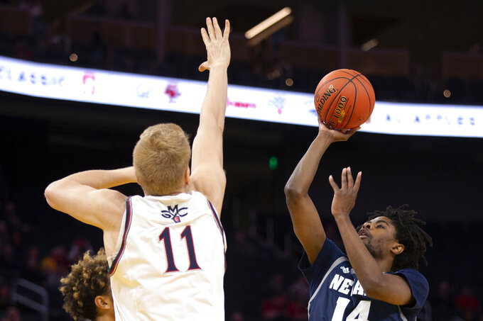 Nevada guard Lindsey Drew (14) shoots over Saint Mary's forward Matthias Tass (11) during the first half of an NCAA college basketball game Saturday, Dec. 21, 2019, in San Francisco. (AP Photo/D. Ross Cameron)