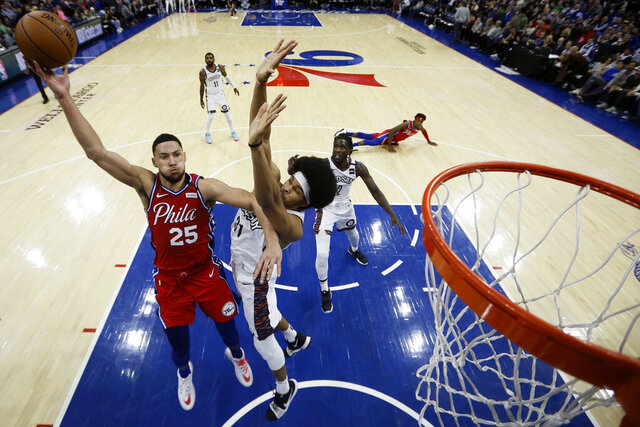 Philadelphia 76ers' Ben Simmons, left, goes up for a shot against Brooklyn Nets' Jarrett Allen during the second half of an NBA basketball game, Wednesday, Jan. 15, 2020, in Philadelphia. (AP Photo/Matt Slocum)
