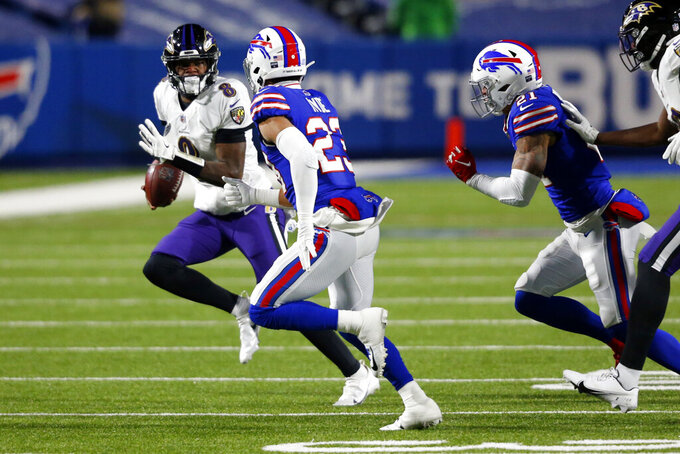 Buffalo Bills' Micah Hyde (23) chases Baltimore Ravens quarterback Lamar Jackson (8) during the first half of an NFL divisional round football game Saturday, Jan. 16, 2021, in Orchard Park, N.Y. (AP Photo/Jeffrey T. Barnes)