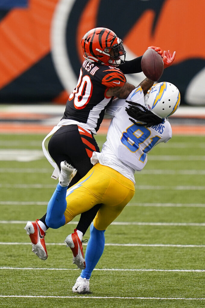 Cincinnati Bengals' Jessie Bates (30) breaks up a pass intended by Los Angeles Chargers' Mike Williams (81) during the second half of an NFL football game, Sunday, Sept. 13, 2020, in Cincinnati. (AP Photo/Bryan Woolston)