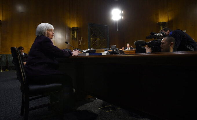 FILE - In this Feb. 24, 2015, file photo Federal Reserve Board Chair Janet Yellen prepares to testify on Capitol Hill in Washington before the Senate Banking Committee. (AP Photo/Susan Walsh, File)