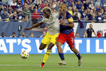 Columbus Crew forward Gyasi Zerdes (11) makes a play for the ball ahead of New England Revolution defender Andrew Farrell (2) during the first half of a MLS soccer match, Saturday, Sept. 18, 2021, in Foxborough, Mass. (AP Photo/Mary Schwalm)