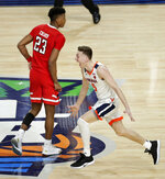 Virginia guard Kyle Guy celebrates in front of Texas Tech guard Jarrett Culver (23) at the end of the the championship game in the Final Four NCAA college basketball tournament, Monday, April 8, 2019, in Minneapolis. Virginia won 85-77 in overtime. (AP Photo/Matt York)
