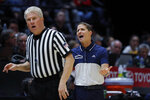Nevada coach Eric Musselman, right, talks to referee Eric Curry during the second half of the team's NCAA college basketball game against San Diego State, Wednesday, Feb. 20, 2019, in San Diego. San Diego State won 65-57. (AP Photo/Gregory Bull)