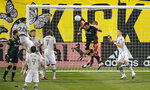 Columbus Crew midfielder Artur (8) goes up for a header against Montreal Impact goalkeeper Clement Diop on a corner kick during the first half of an MLS soccer match in Columbus, Ohio, Wednesday, Oct. 7, 2020. (Kyle Robertson/The Columbus Dispatch via AP)