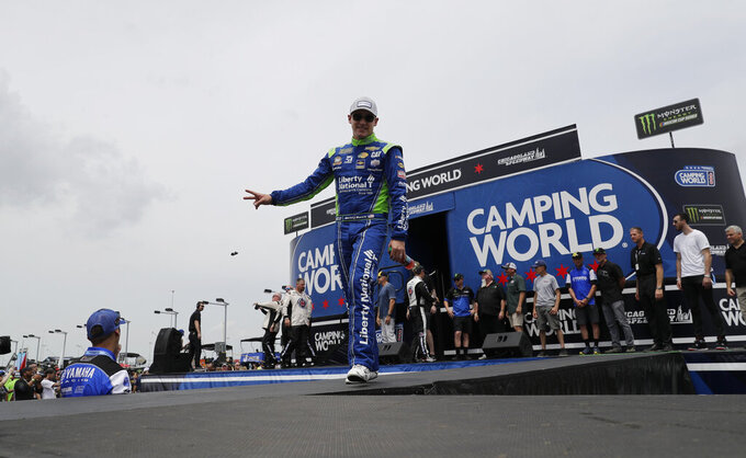 Daniel Hemric waves to the crowd during drivers introduction before the NASCAR Cup Series auto race at Chicagoland Speedway in Joliet, Ill., Sunday, June 30, 2019. (AP Photo/Nam Y. Huh)