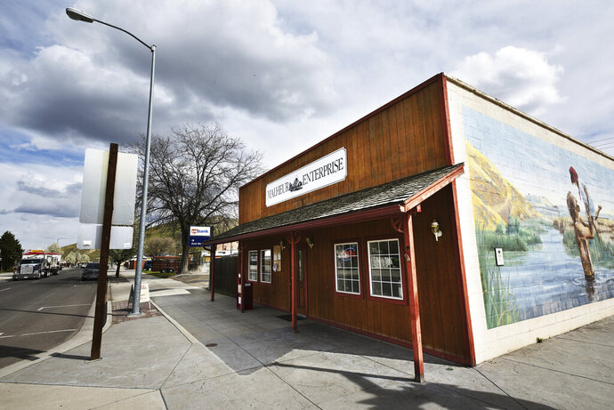 In this Monday, April 16, 2018, photo shows The Malheur Enterprise, a small weekly newspaper located in the agricultural town of Vale, east of Ontario, Ore. Journalists in Oregon and beyond have risen in defense of a small newspaper that is being investigated by a county sheriff for trying to get comments after business hours for an investigative story. Staffers at the Malheur Enterprise, a weekly newspaper in the remote eastern Oregon town of Vale, say they are just doing their job.  (E.J. Harris/East Oregonian via AP) /East Oregonian via AP)