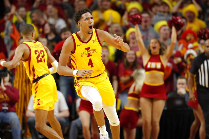 Iowa State forward George Conditt reacts after scoring against Seton Hall during the first half of an NCAA college basketball game, Sunday, Dec. 8, 2019, in Ames, Iowa. (AP Photo/Matthew Putney)