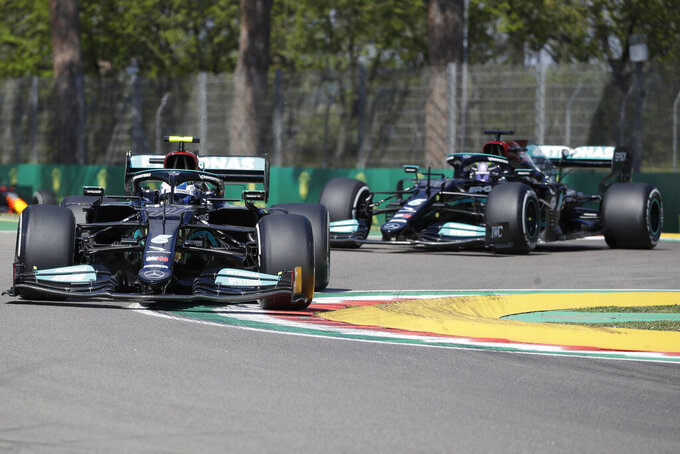Mercedes driver Valtteri Bottas of Finland is followed by Mercedes driver Lewis Hamilton of Britain during free practice for Sunday's Emilia Romagna Formula One Grand Prix, at the Imola track, Italy, Friday, April 16, 2021. (AP Photo/Luca Bruno)