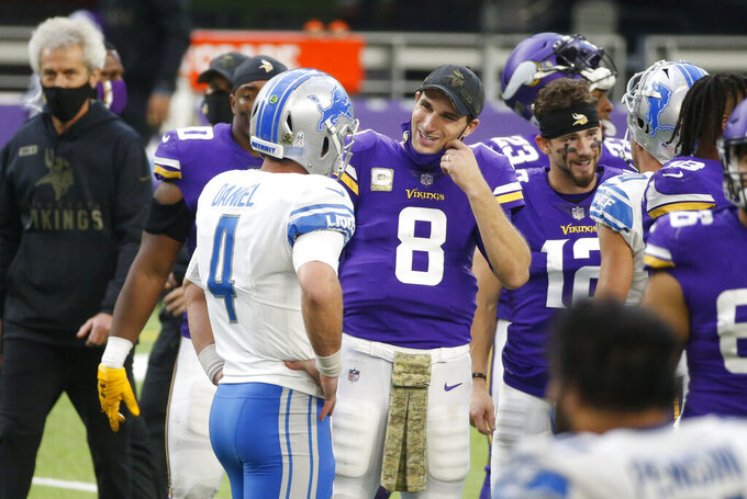 Minnesota Vikings quarterback Kirk Cousins (8) talks with Detroit Lions quarterback Chase Daniel (4) after an NFL football game, Sunday, Nov. 8, 2020, in Minneapolis. The Vikings won 34-20. (AP Photo/Bruce Kluckhohn)