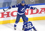 Tampa Bay Lightning defenseman Victor Hedman (77) celebrates his goal against the New York Islanders with Barclay Goodrow (19) during the second period of Game 5 of the NHL hockey Eastern Conference final, Tuesday, Sept. 15, 2020, in Edmonton, Alberta. (Jason Franson/The Canadian Press via AP)