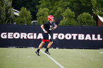 Georgia quarterback Jake Fromm (11) runs during the team's first scheduled NCAA college football practice Friday, Aug. 2, 2019, in Athens, Ga. (AP Photo/John Bazemore)