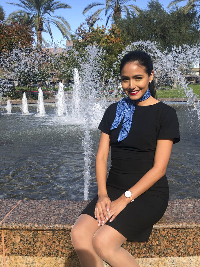 This 2018 photo provided by Feldman Strategies shows Selene Saavedra Roman. Selene Saavedra Roman, a flight attendant who traveled to Mexico for work with employment authorization through a program for immigrants brought to the country as children has been detained. Attorney Belinda Arroyo said Friday, March 22, 2019, that Mesa Airlines mistakenly assured 28-year-old Selene Saavedra Roman she could travel internationally but she was detained on her way back. Immigration and Customs Enforcement says she didn't have a valid document to enter the country. (Davo Watsui/Feldman Strategies via AP)
