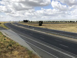 CORRECTS TO PARKED, NOT MOVING - A California Highway Patrol car is parked along an empty Interstate 215 on Friday, May 17, 2019, in California. A wide area including the 215 freeway remained off-limits around an F-16 fighter jet crash site in Southern California on Friday as military and civilian authorities investigated. (AP Photo/Amy Taxin)