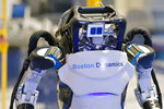 A Boston Dynamics Atlas robot performs a movement during a demonstration, Wednesday, Jan. 13, 2021, at the company's facilities in Waltham, Mass. The company engineered the robot to be able to dance in a fluid manner that is almost human. (AP Photo/Josh Reynolds)