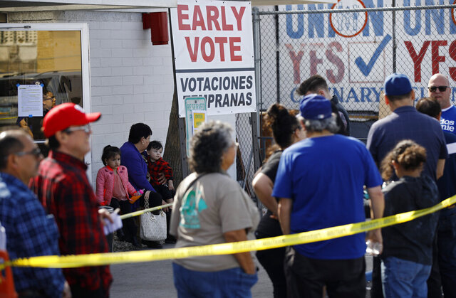 People wait in line to vote early at the Culinary Workers union Monday, Feb. 17, 2020, in Las Vegas. (AP Photo/John Locher)