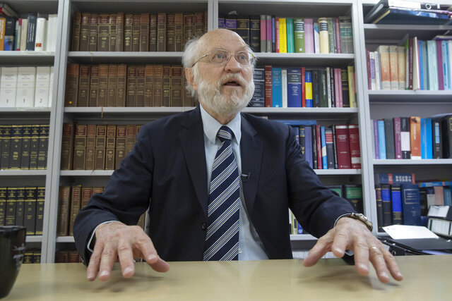 John Clancey, an American lawyer who became the first foreigner arrested under Hong Kong's national security law, speaks during an interview in Hong Kong, Friday, Jan. 15, 2021. Clancey said Friday that the courts now have a choice between the new law and the city's legally enshrined freedoms, as China cracks down on dissent in the Asian financial capital.  (AP Photo/Kin Cheung)
