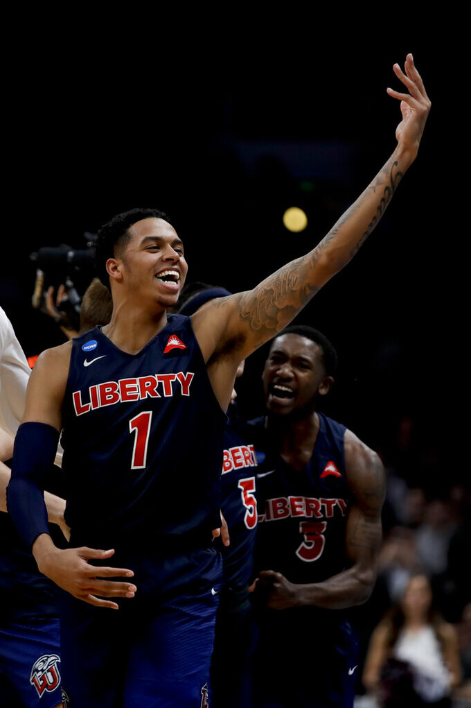 Liberty guard Caleb Homesley celebrates after the team's win against Mississippi State in a first-round game in the NCAA men's college basketball tournament Friday, March 22, 2019, in San Jose, Calif. (AP Photo/Ben Margot)
