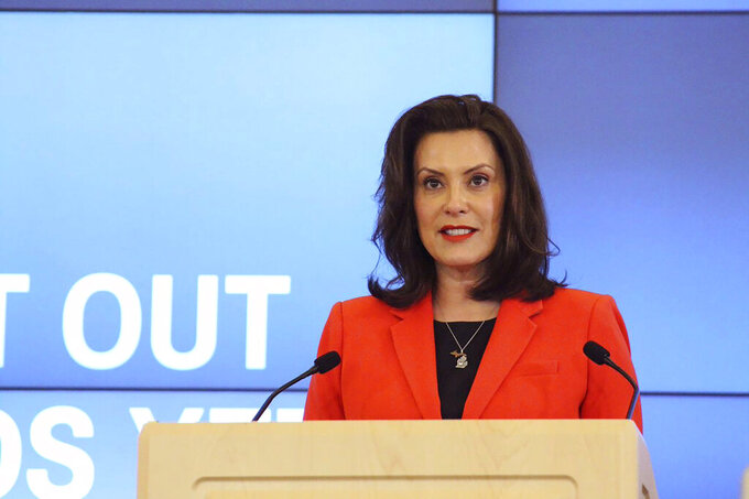 """In a photo provided by the governor's office, Michigan Gov. Gretchen Whitmer speaks in Lansing, Mich., Monday, May 4, 2020. Whitmer's administration says hospitals and physicians have """"broad discretion"""" to decide whether to delay nonessential procedures during the pandemic. In-person contact should be limited as much as possible. But if physicians determine it is necessary, they should take steps such as asking patients to wait in their car until their appointment and requiring masks. (Michigan Office of the Governor via AP, Pool)"""