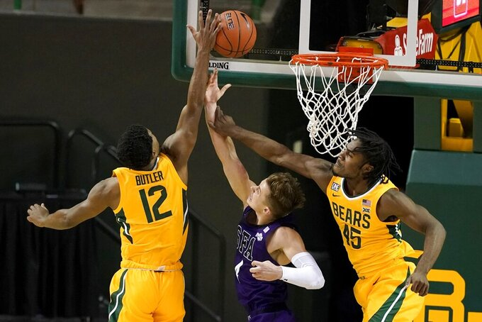 Baylor's Jared Butler (12) blocks a shot attempt by Stephen F. Austin's David Kachelries (4) as Baylor guard Davion Mitchell (45) helps defend on the play during the first half of an NCAA college basketball game in Waco, Texas, Wednesday, Dec. 9, 2020. (AP Photo/Tony Gutierrez)