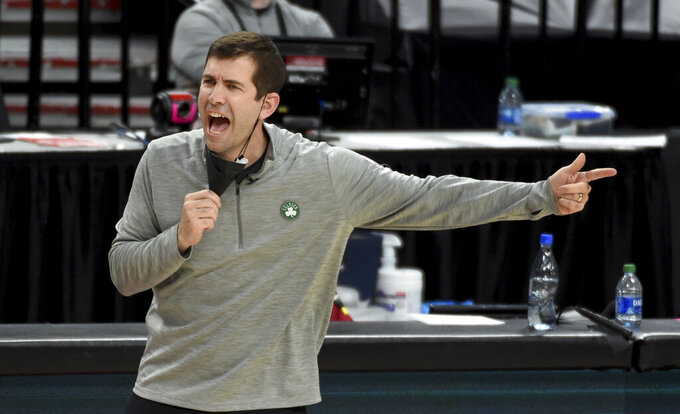 Boston Celtics coach Brad Stevens reacts to an official's call during the second half of the team's NBA basketball game against the Portland Trail Blazers in Portland, Ore., Tuesday, April 13, 2021. The Celtics won 116-115. (AP Photo/Steve Dykes)