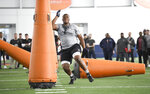 Defensive tackle Derrick Brown works out during Auburn NCAA college football Pro Day Friday, March 6, 2020, in Auburn, Ala. (AP Photo/Julie Bennett)